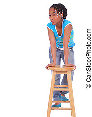 African American Girl Posing With Chair