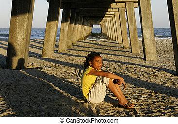 African-american Girl Sitting on Beach