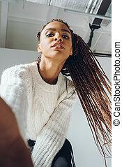 african american girl taking selfie