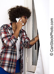 african american girl talking on mobile phone