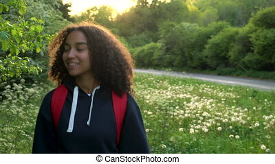 African American girl teenager female young woman hiking at sunset