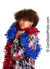 african american girl with christmas ornaments