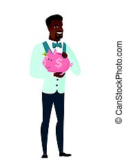 African-american groom holding a piggy bank.