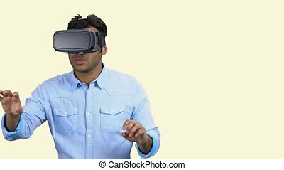 African-american guy wearing vr glasses. Dark-skinned man using vr headset. Space for text. Future technology concept.