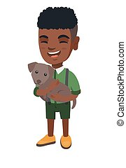 African-american happy boy holding a dog.