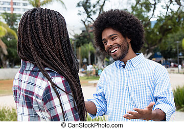 African american hipster man flirting with woman