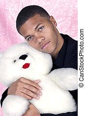 African American holding teddy bear