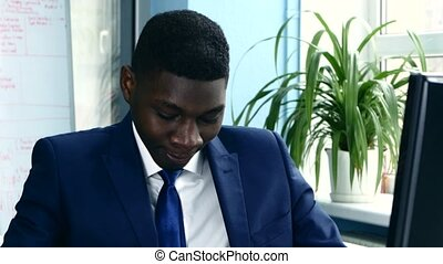African American in a suit rubbing his hands before starting work