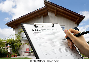 African American Inspector Checking Building Report