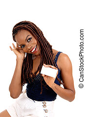 African American lady holding business card.