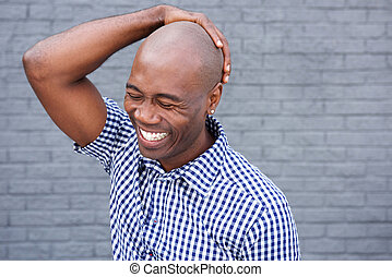 African american laughing with hand on head - Close up...