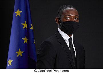 African-American Leader Wearing Mask