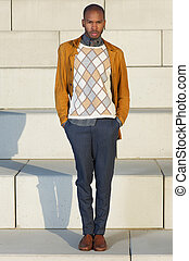 African american male fashion model standing outdoors