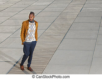 African american male fashion model walking outdoors