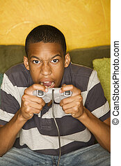 African-american male playing video games