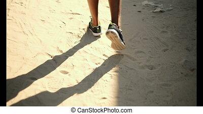 African American male runner jogging near beach 4k - Low ...