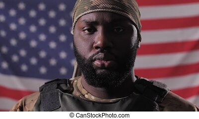 African american male soldier against USA flag