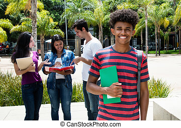 African american male student with group of other international students