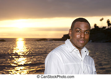 African American man against a sunset