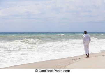 African American Man Alone on a Beach