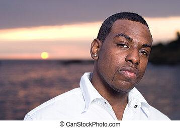 African American man at beach - An African American man...