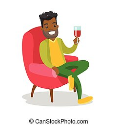 African-american man drinking wine in the chair.