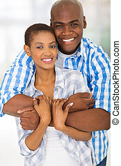african american man hugging girlfriend