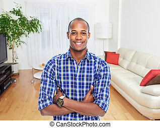 African-american man in new apartment.