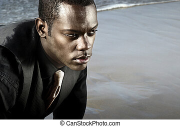 african american man in suit on the ocean