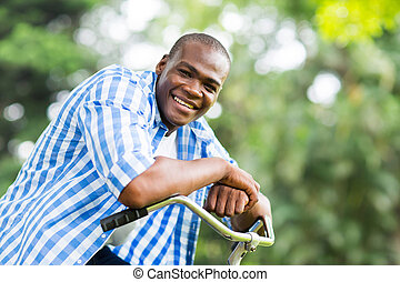 african american man on a bicycle