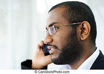 African American man on the phone
