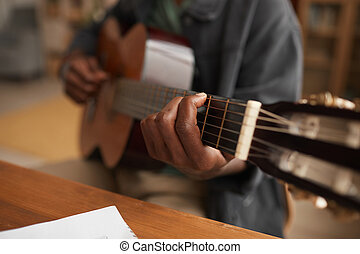 African-American Man Playing Guitar Close Up