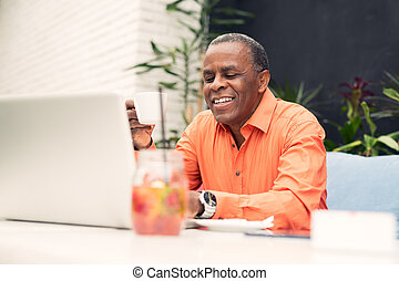 African American man sitting in a cafe