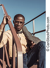 african american man sitting on stairs
