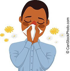 Young sick African American man ill suffering spring allergy using white tissue on nose