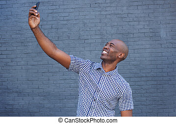 African american man taking a selfie with mobile phone