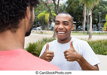 African american man talking with friend