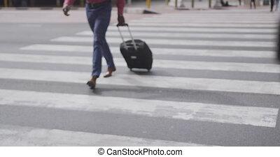 African American man walking on the zebra crossing - African...
