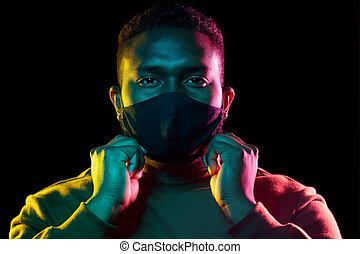 african american man wearing black reusable mask
