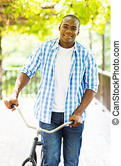 african american man with a bicycle