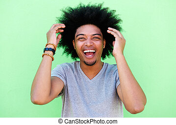 African american man with afro laughing
