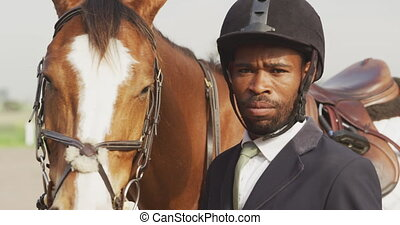 African American man with his Dressage horse - Portrait of a...