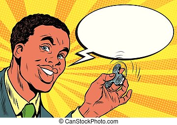 African American man with the spinner in hand. Pop art retro...