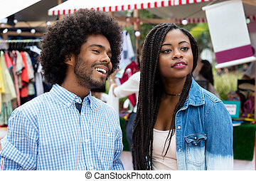 African american man with wife at market