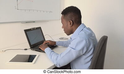 Manager working at a computer