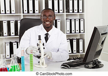 african american medical scientist wearing lab coat with ...