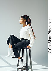 african american model posing with stool