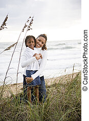 African-American mother and daughter at beach
