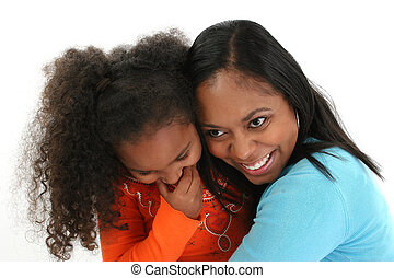 African American Mother and Daughter Hugging - Attractive...