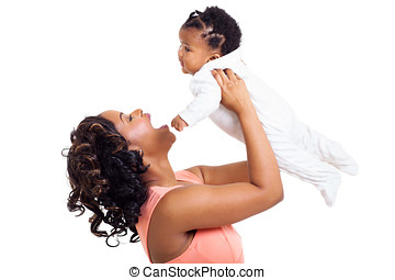 african american mother playing with baby daughter -...